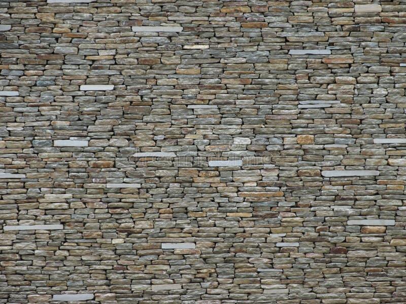 Stentegelstenvägg i ljusa färger arkivfoton
