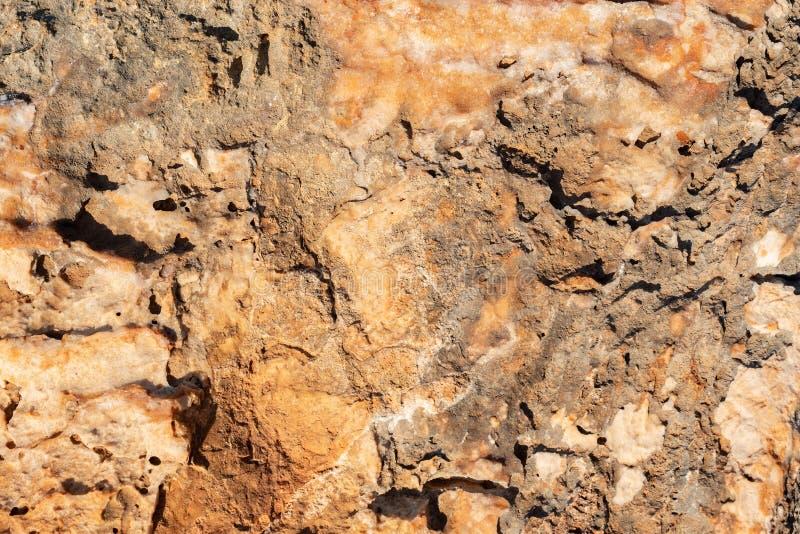 Stentextur i bruna signaler arkivfoto