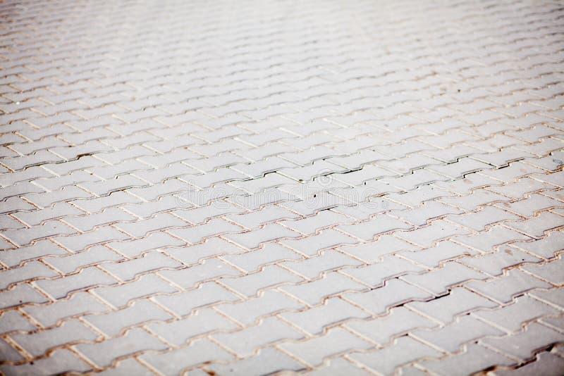 Stentrottoartextur cobblestoned granittrottoar för bakgrund Abstrakt bakgrund av den gamla kullerstentrottoarnärbilden arkivfoto