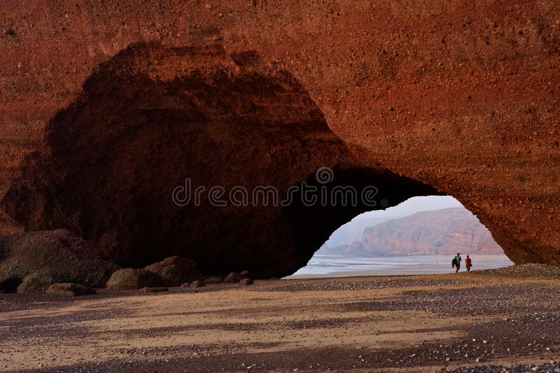 Step into another world. Stone arches at Morocco. Amazing creation of waves and wind. Atlantic ocean. Legzira royalty free stock image