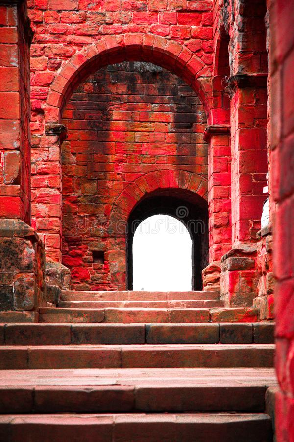 Step and arched doorways on red brick medieval ancient ruins stock photos