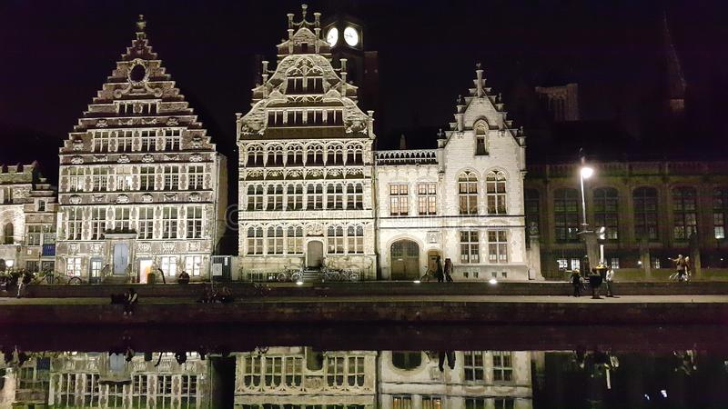 Step-Gabled Guild-houses and their reflections,and people, Ghent royalty free stock image