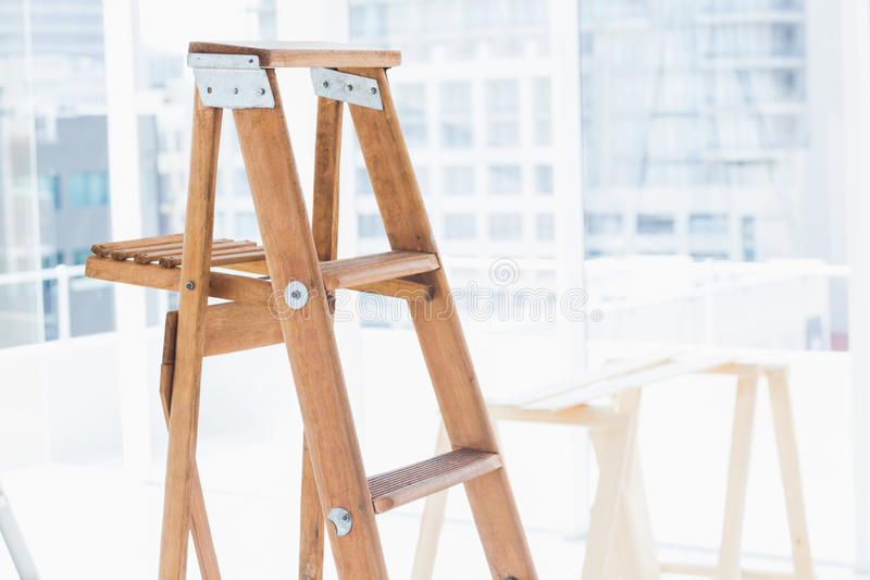 Step ladder in bright office stock photography