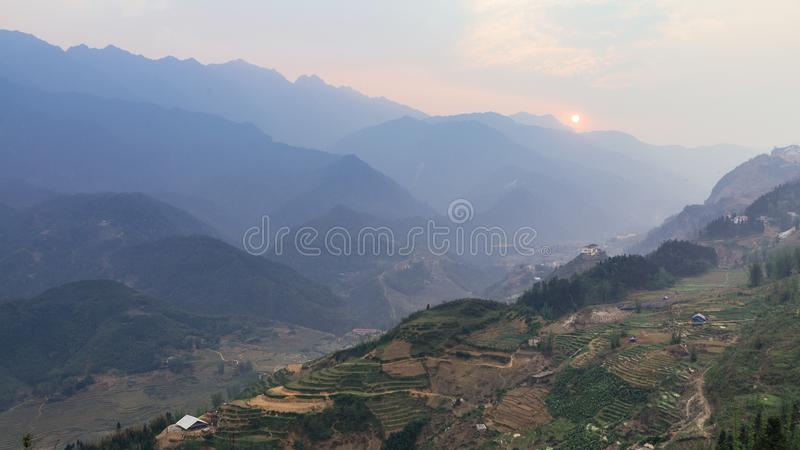 Step ladder planted on the hill with fog and mountain in the background in summer in the dusk in Sa Pa, Vietnam stock images