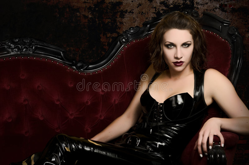 Step into my Lair - Female Vampire in Catsuit stock images