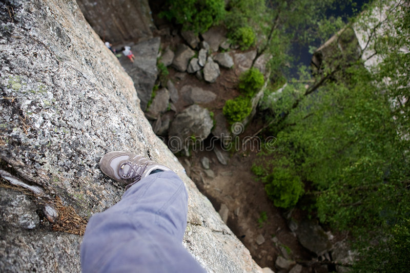 Step out on a Ledge stock photography