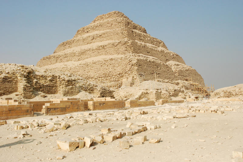 Step Pyramid of Djoser, Saqqara, Egypt. The Pyramid of Djoser (Zoser), or step pyramid an archeological remain in the Saqqara necropolis, Egypt, northwest of the royalty free stock photo