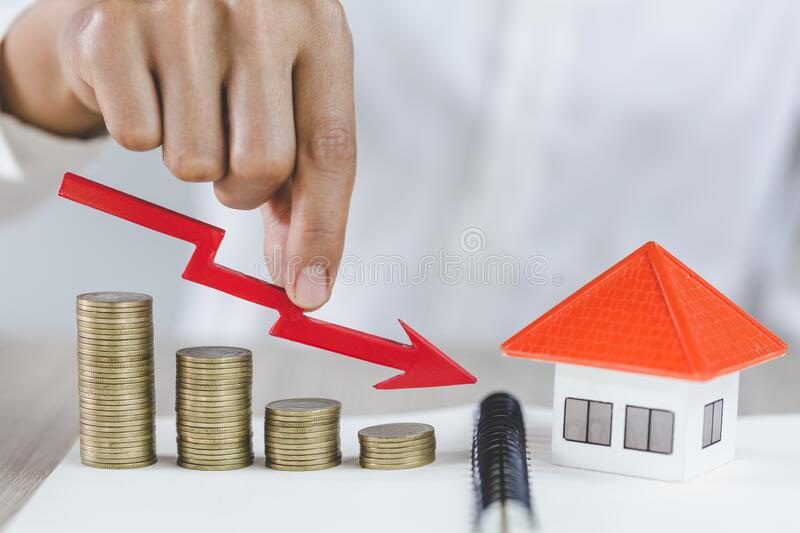 Step stack coins as graph down. The concept of failure and risk in the property market. The fall and crisis of the real estate royalty free stock photo