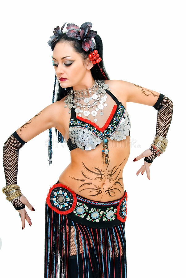 Step in tribal dance. Charming beauty tribal dancer on white background royalty free stock image