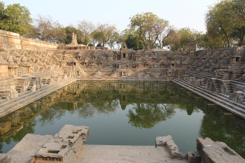 Step well of Modhera with reflection in water royalty free stock image