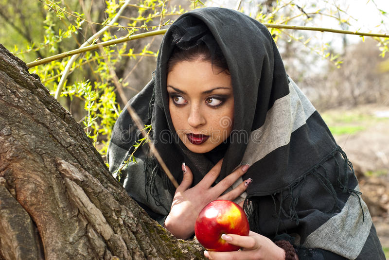 Stepmother casts a spell over the apple royalty free stock photo