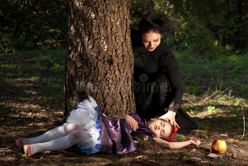 Stepmother gives poisoned apple to snow white royalty free stock photo