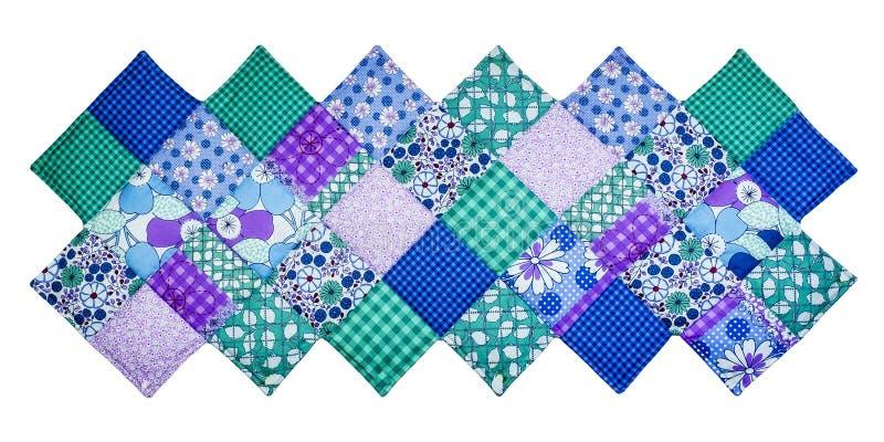 Steppdecke mit diagonalem Quadrat lizenzfreie stockfotos