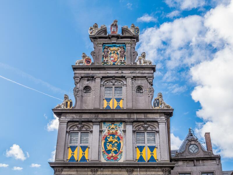Stepped gable and coat of arms of former Statencollege, now Westfries Museum, Hoorn, Netherlands. Top facade with stepped gable and coats of arms of former stock photography