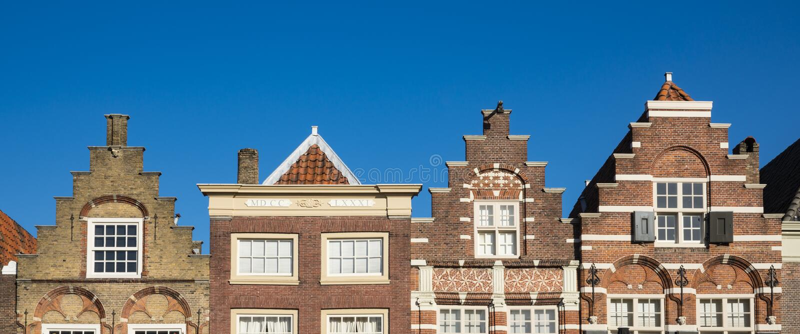 Stepped gable Houses in Nieuwstraat. Dordrecht. The Netherlands. Banner detail of typical Dutch stepped gable houses in Nieuwstraat. Dordrecht. The Netherlands stock photography