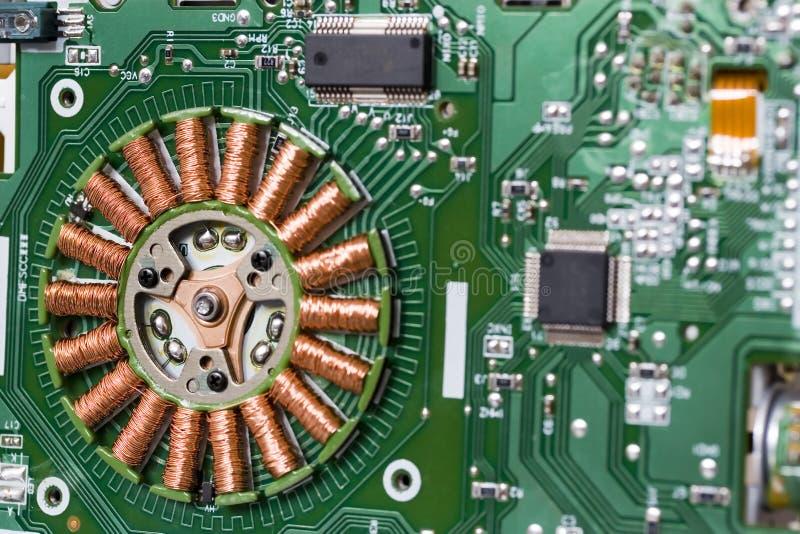 Stepper motor. Electric stepper motor in FDD drive stock photos