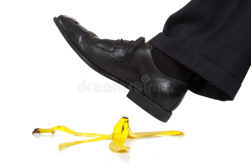Stepping on a Banana Peel royalty free stock images