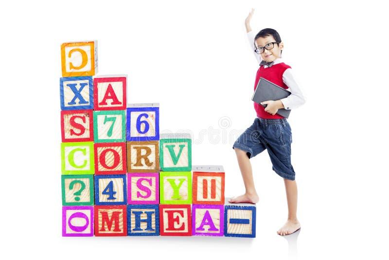 Stepping upward alphabet block 1 stock image