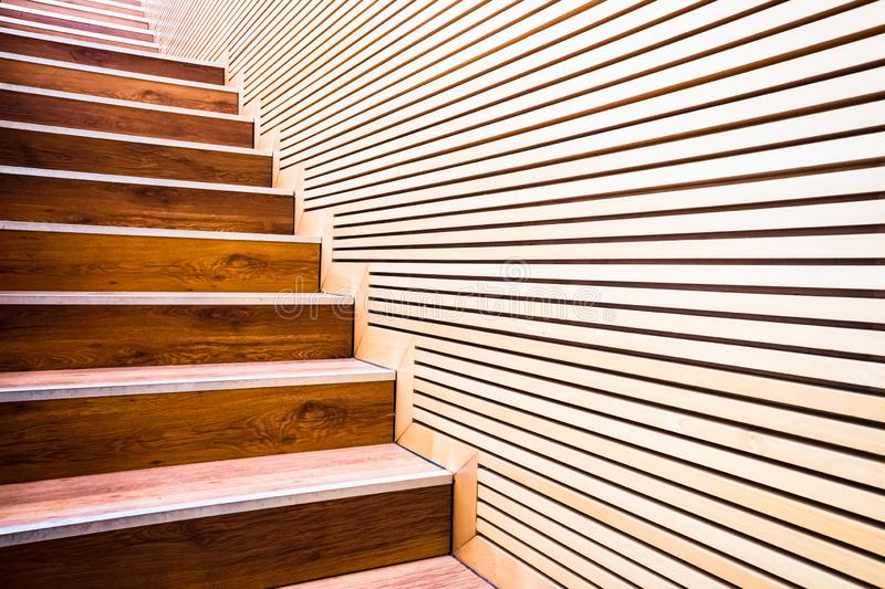 Steps on a ladder next to a wall of wooden boards in sustainable construction stock photos