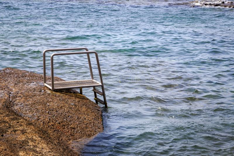 Steps leading into the sea royalty free stock photo