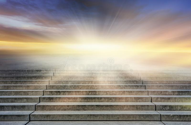 Steps leading up to the sun. Way to God . bright light from heaven . royalty free stock photography