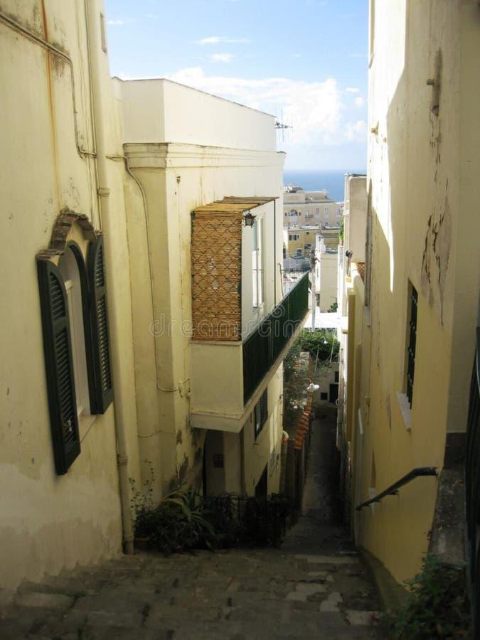 Steps on slanty narrow street stock photos