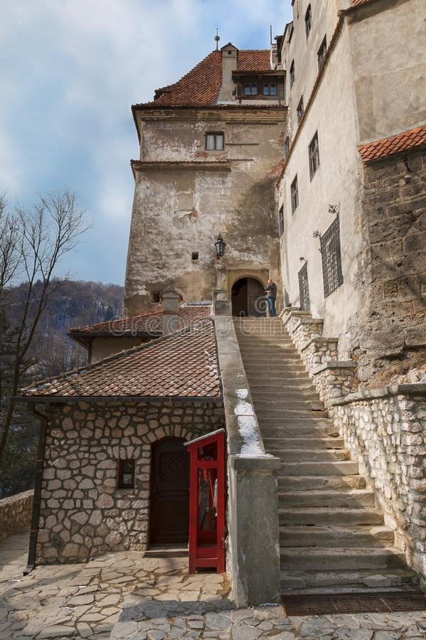 Steps of a stone staircase leading to the medieval Bran castle Dracula`s castle in Romania royalty free stock photo