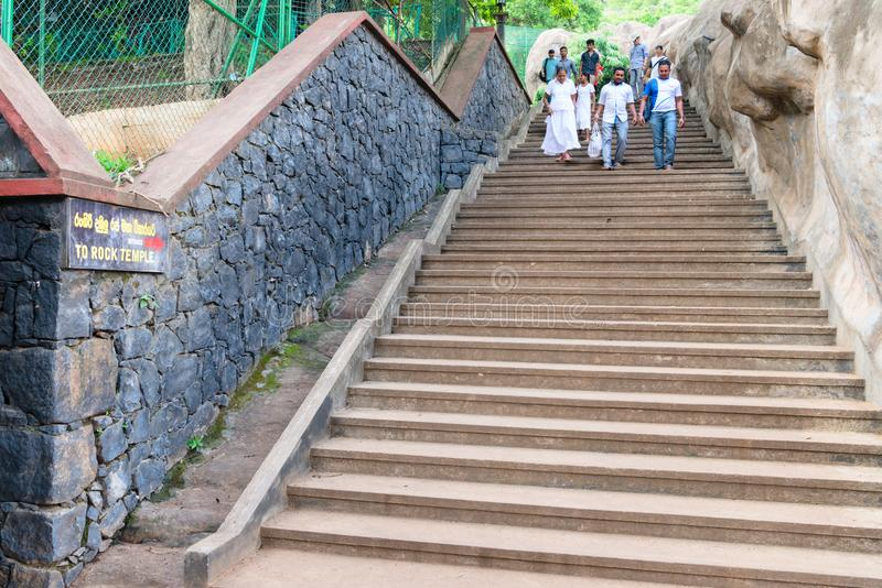 Steps to Dambulla Golden cave temple complex on the hill top wit. DAMBULLA, SRI LANKA - NOV 2016: Steps to Golden cave temple complex on the hill top with royalty free stock photos
