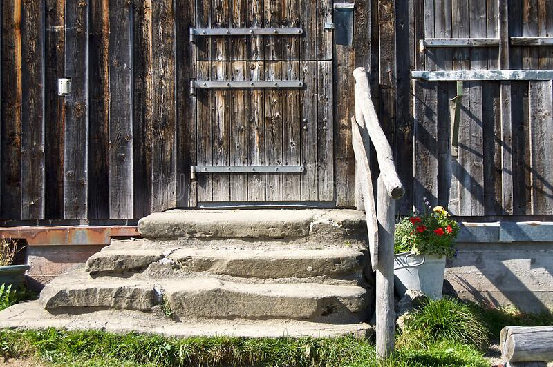 Steps to old wooden door stock image
