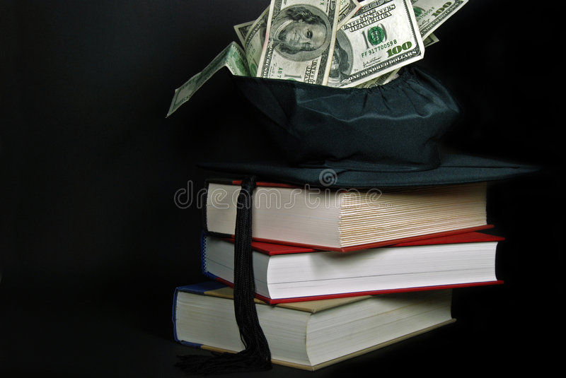 money in graduation cap royalty free stock image