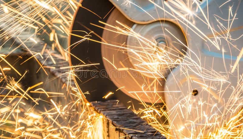 Disc cutter. Making sparks with a disc cutter royalty free stock image