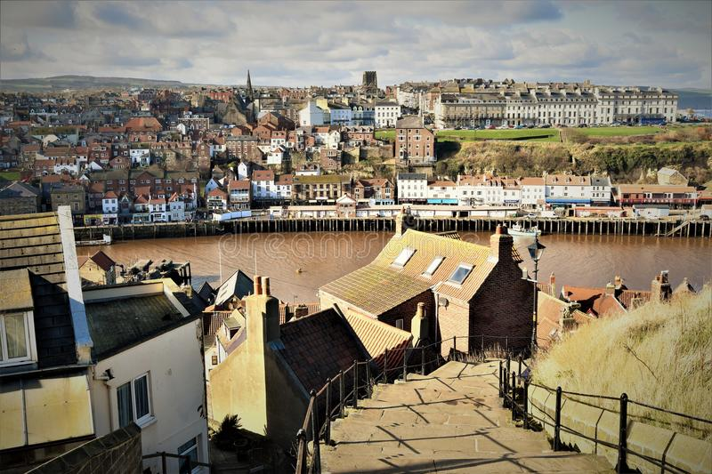 The 199 steps and the town of Whitby in very early spring. stock images