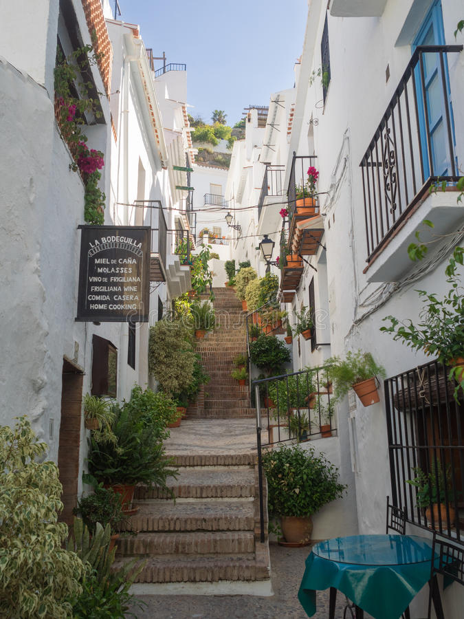 A steep climb up the cobbled steps in the white village (pueblo blanco) of Frigiliana in Andalusia, Spain - April 2015 stock photos