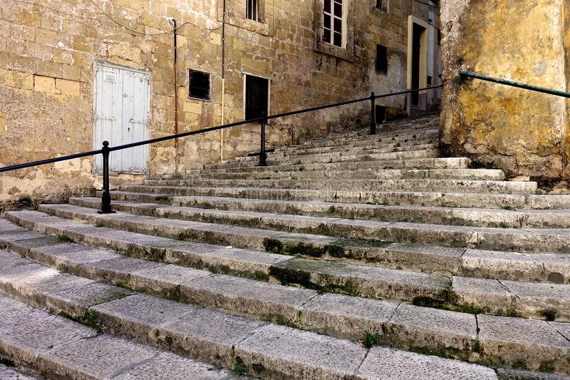 Steps in Valletta, Malta. Steep stone steps in the historic capital of Valletta, Malta, connect one street to another. When the city was built in the mid-1500 royalty free stock photos