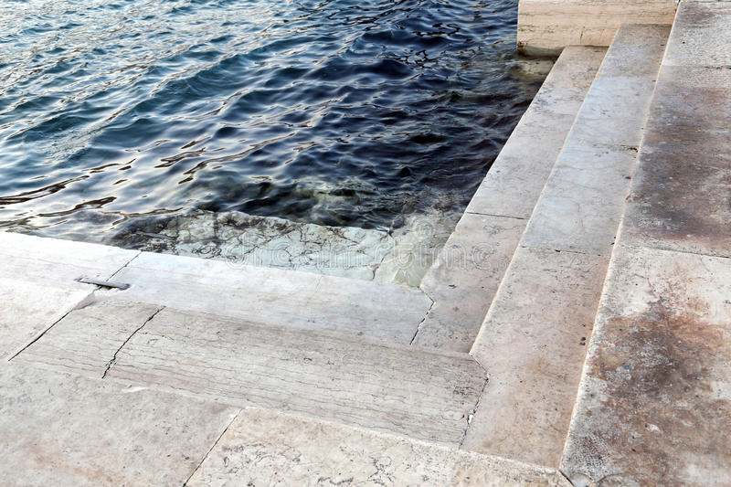 Stepsr submerged at high tide in Venice in Italy. Steps from the water submerged at high tide in Venice in Italy stock photography