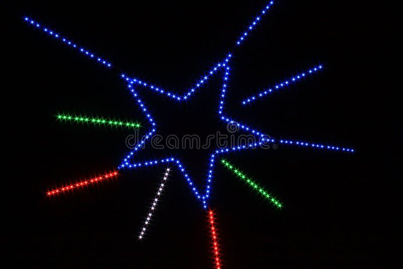 Ster lichte veelkleurig in vorm van grote ster royalty-vrije stock afbeelding