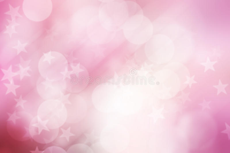 Ster op roze en witte, abstracte bokehachtergrond stock foto's