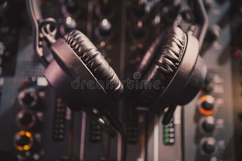 Professional dj sound mixer and headphones with music royalty free stock photos