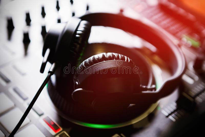 Professional dj sound mixer and headphones with music stock image