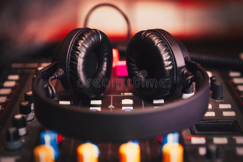 Professional dj sound mixer and headphones with music stock photos