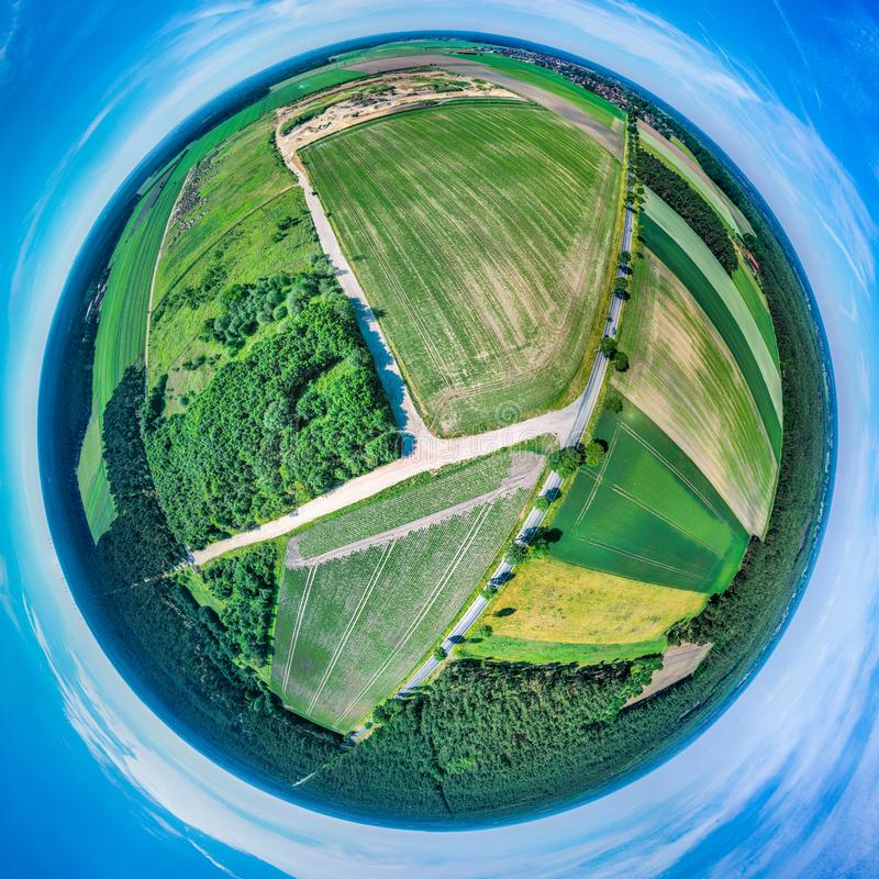 Stereoscopic spherical panorama of a flat landscape in Northern Germany with fields, meadows and forests, aerial photograph, drone. Stereoscopic spherical stock image