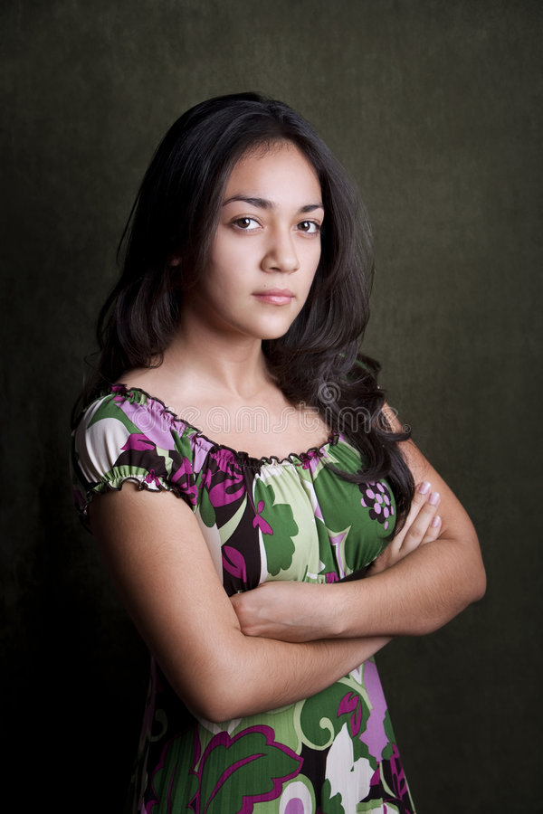 Sterh Hispanic Girl. Hispanic girl with arms folded and stern expression stock image