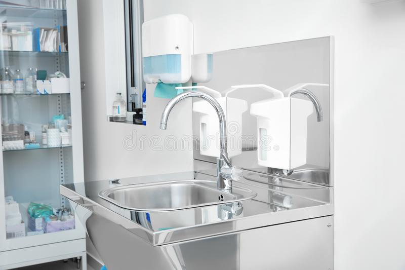Sterile steel washbasin in modern surgery stock images