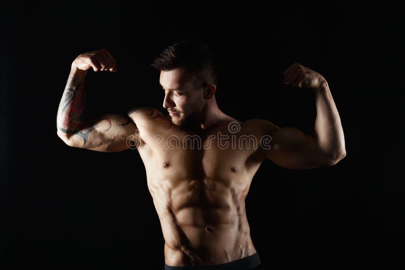 Sterk atletisch mensen showes naakt spierlichaam royalty-vrije stock foto