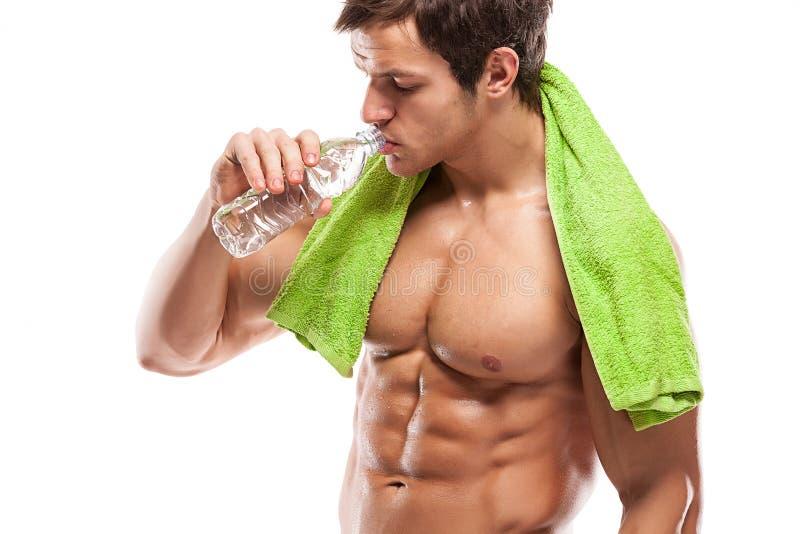 Sterk Atletisch Mensengeschiktheid Model het drinken zoet water royalty-vrije stock foto's