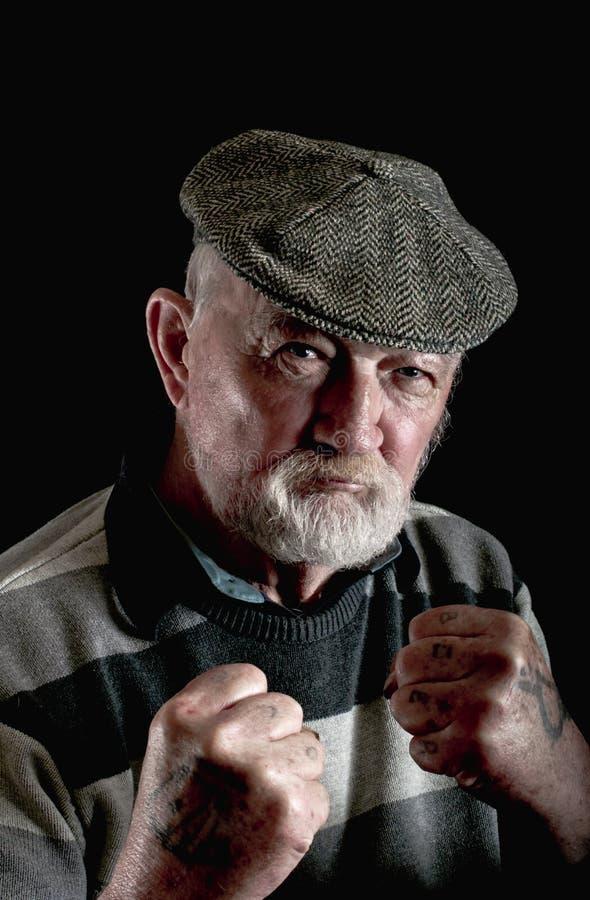 Sterke en taaie oude mens stock foto's