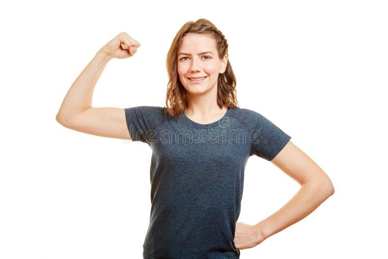 Sterke jonge vrouw als Persoonlijke Trainer stock afbeelding