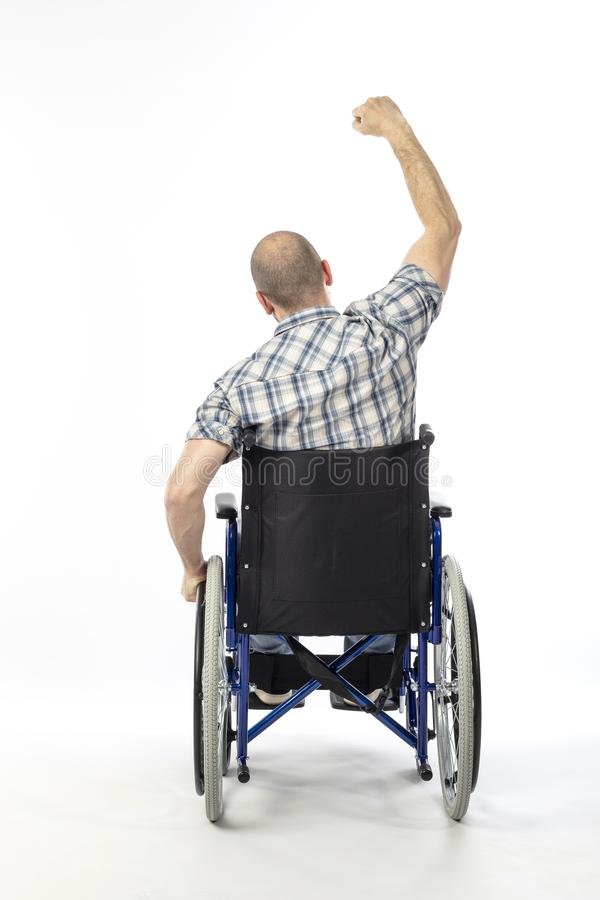 Sterke mens in wheelschair stock foto's