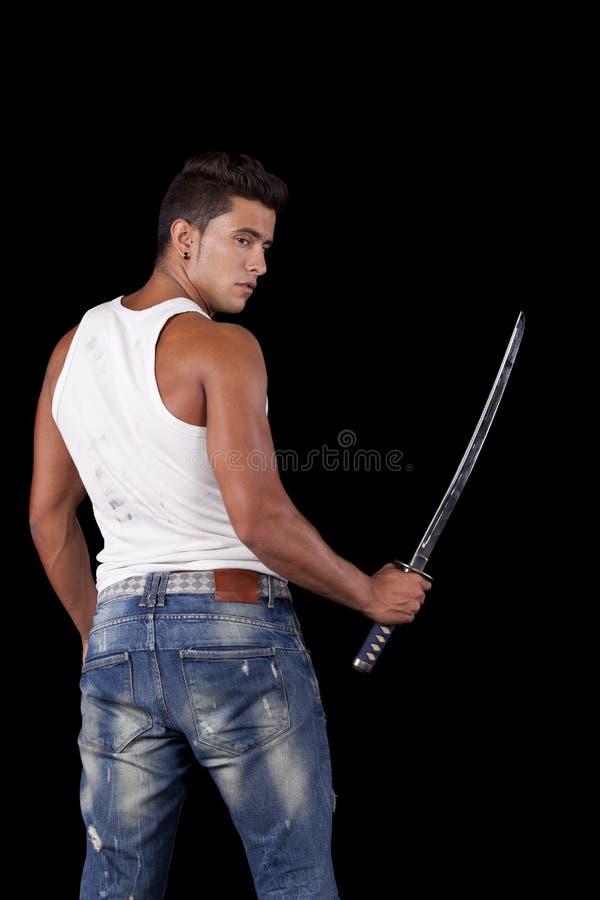 Sterke strijder met ninjazwaarden stock afbeeldingen