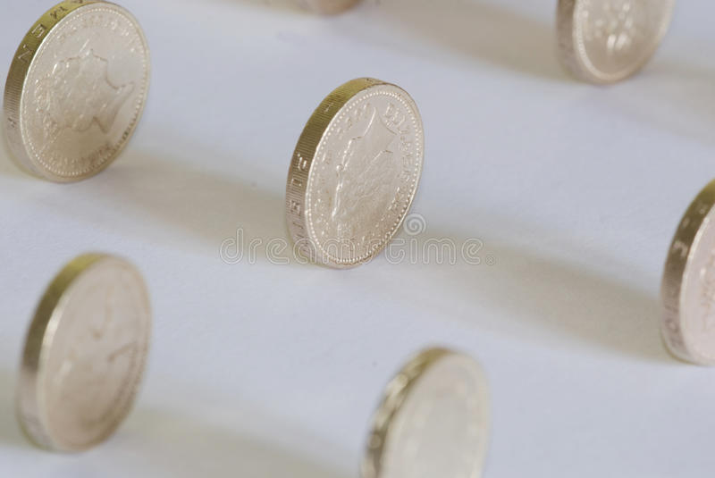 Sterling one pound coins royalty free stock photo